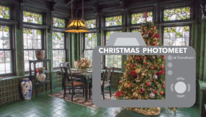 Photo of Glensheen's green tiled breakfast room with christmas tree and camera graphic design