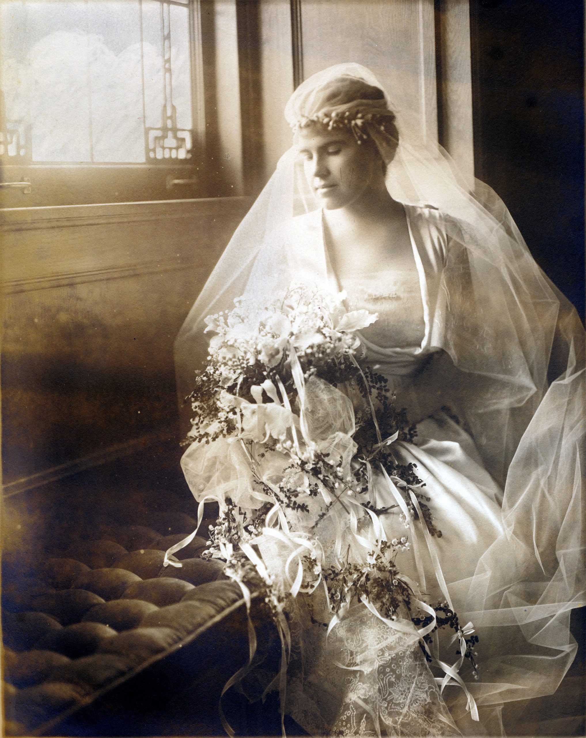 Marjorie looks at her bouquet on her wedding day.