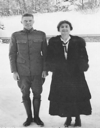 Helen and her husband Hubert stand next to each other for a picture on a winter day.