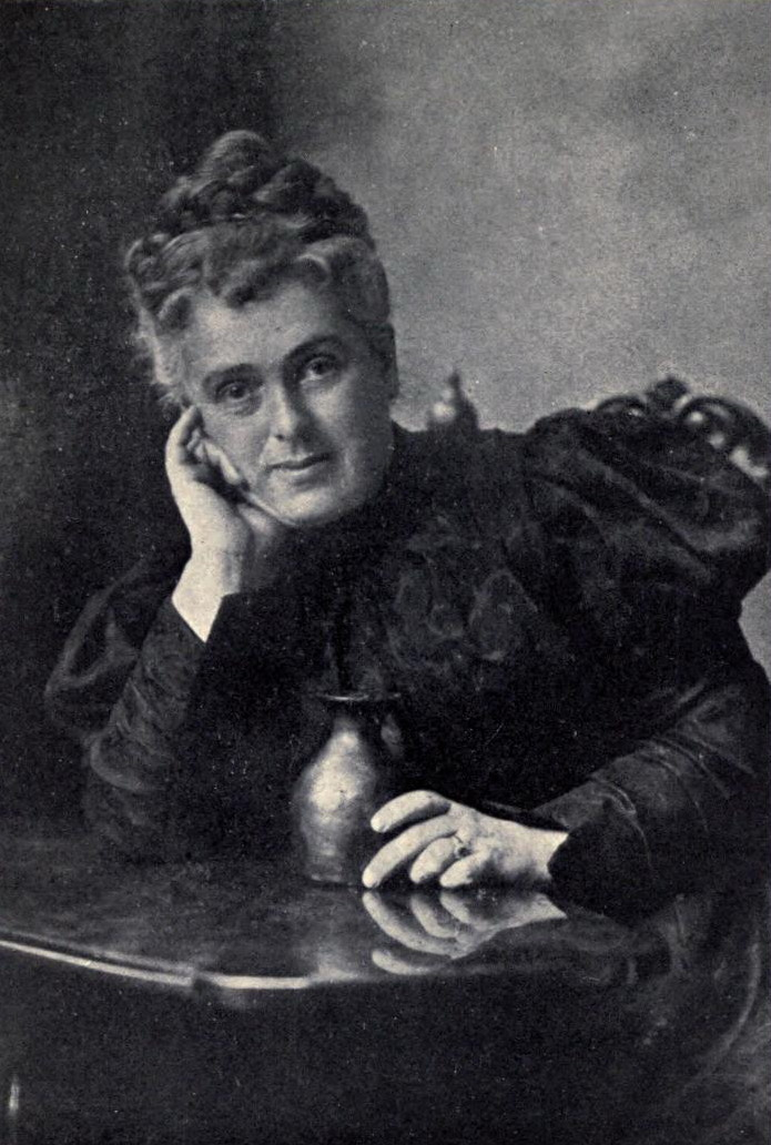 Maria Longworth Storer poses for a portrait with her head resting on her hand.