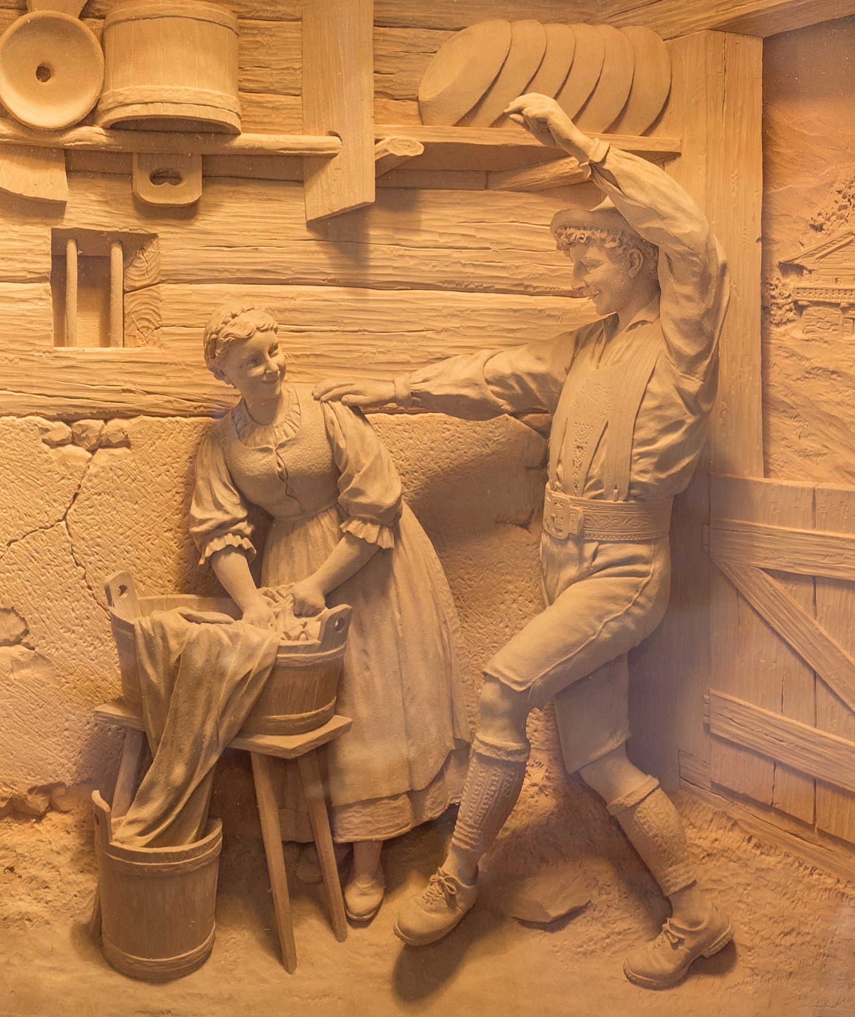 Wood carving of couple dancing.