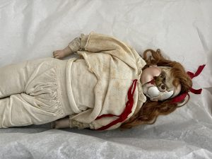creepy old doll with face missing